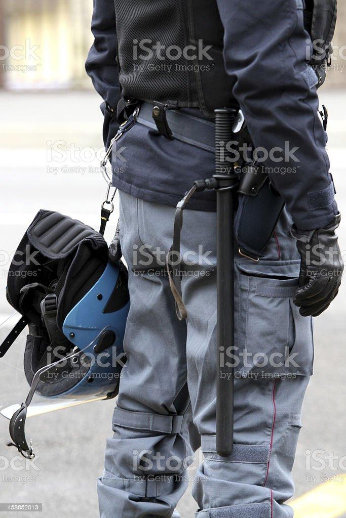 policeman with truncheon, helmet gun and handcuffs stock photo