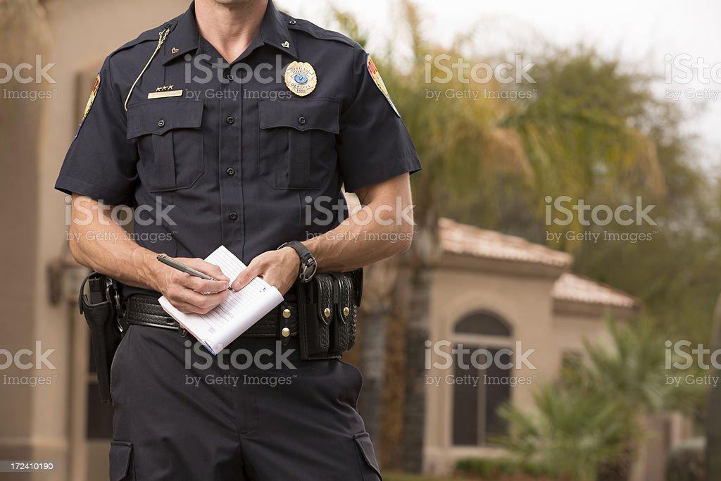 Policeman writting a ticket stock photo