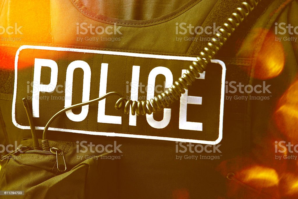 Policeman's sign and cord on protective jacket stock photo