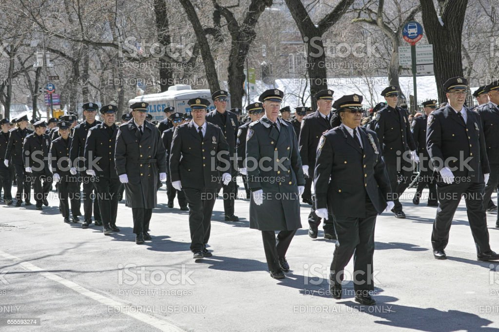 Policemen and policewomen in formal uniforms at 2017 St. Patrick's Day Parade in New York City stock photo