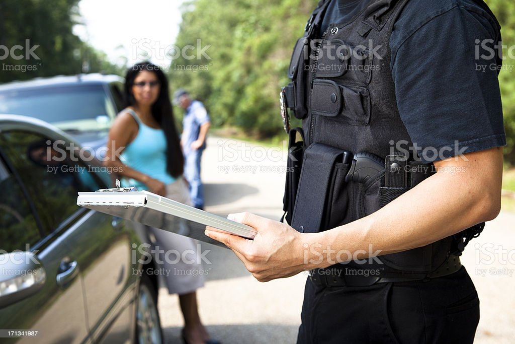 Policemen and woman during traffic stop royalty-free stock photo