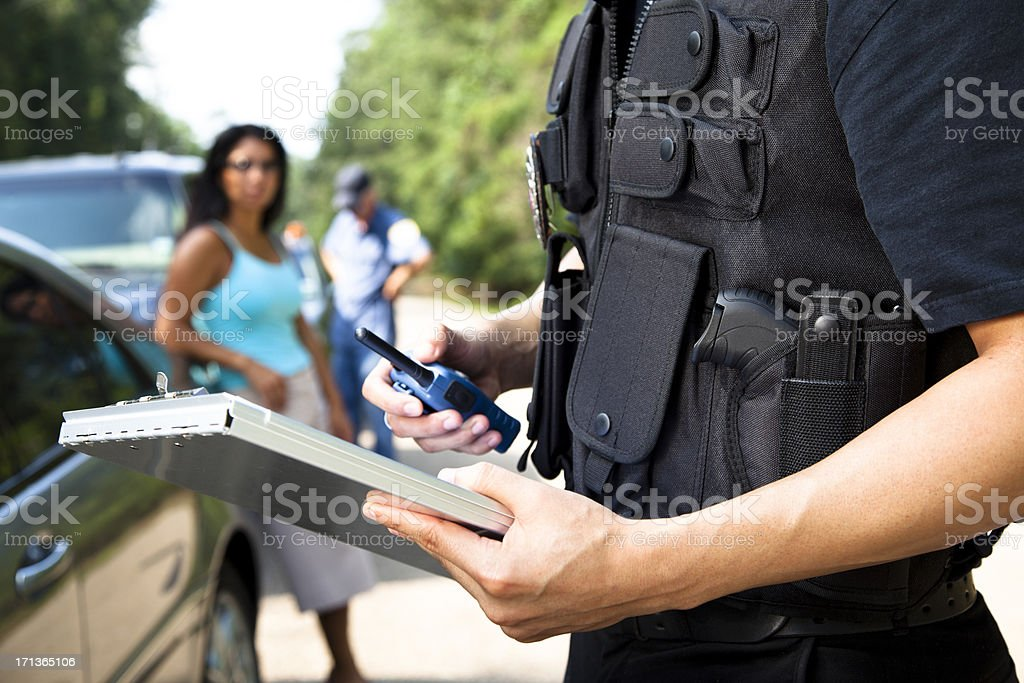 Policemen and woman during traffic stop stock photo