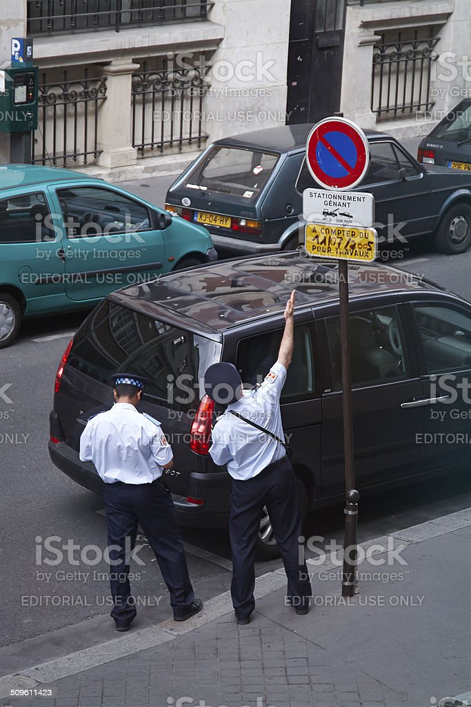 Policemen discussing a parked car stock photo