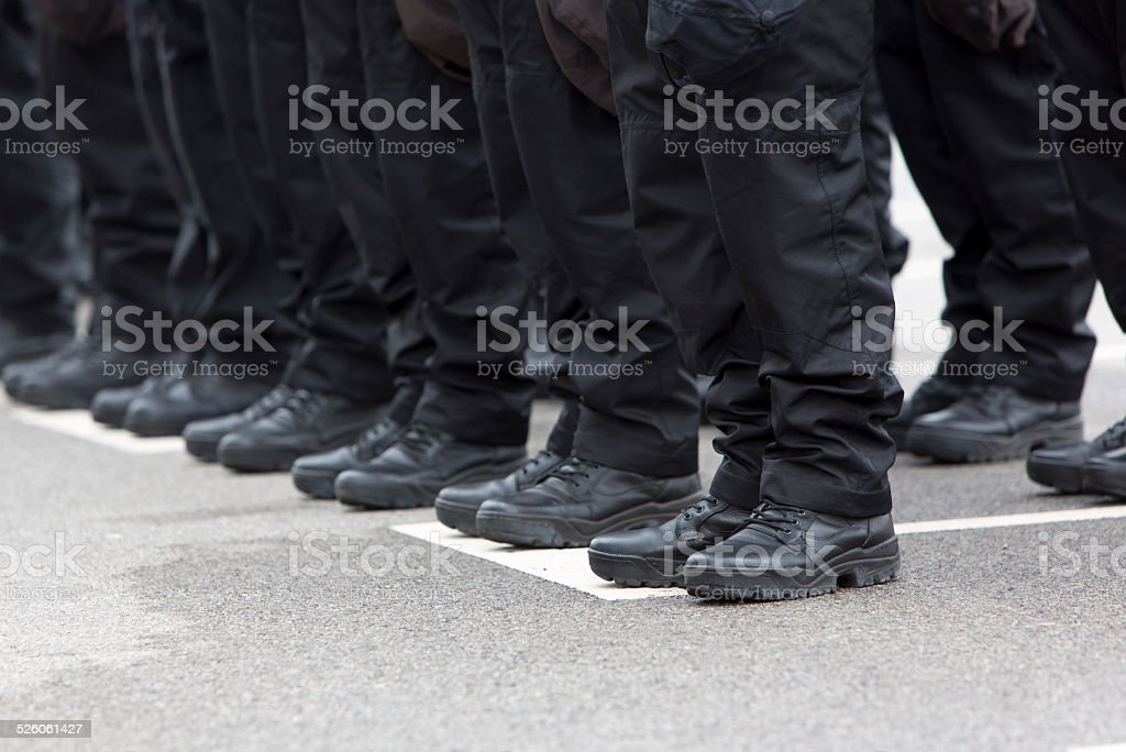 Policemen legs and boots stock photo