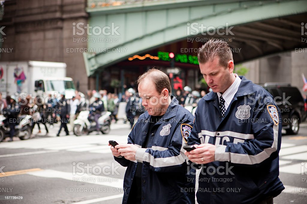 Policemen on 42nd street using their mobile phone, New York stock photo