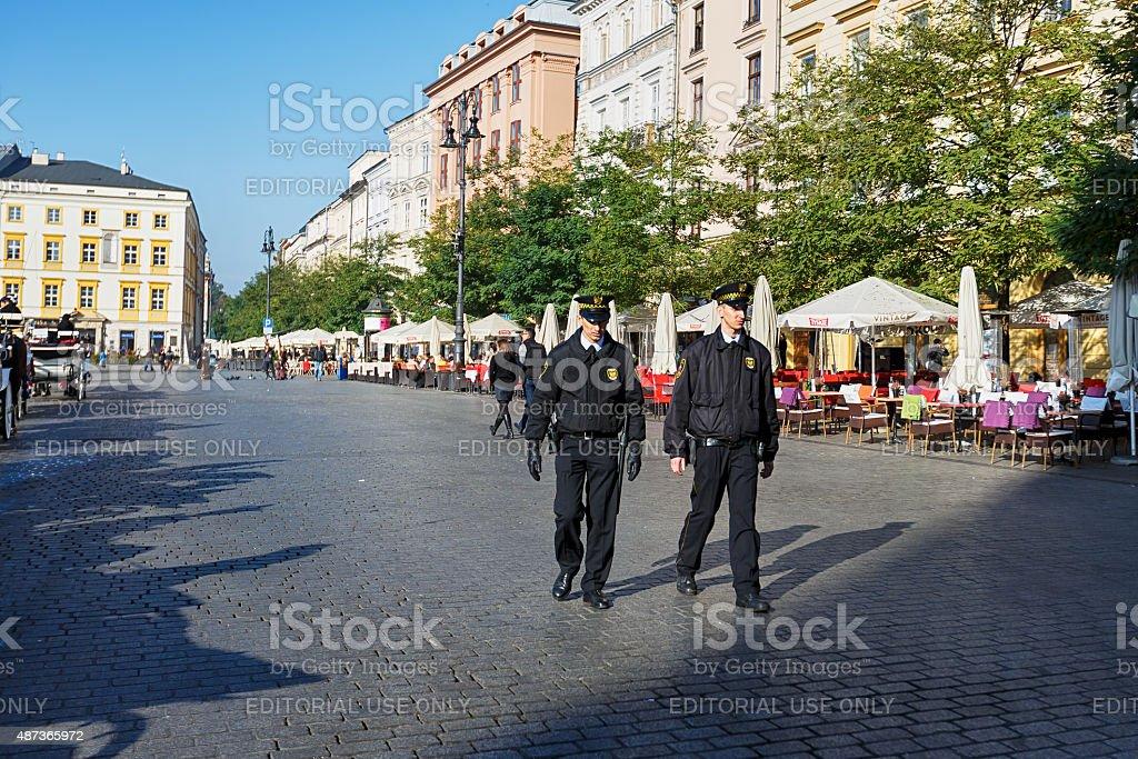 Policemen patrol the city stock photo