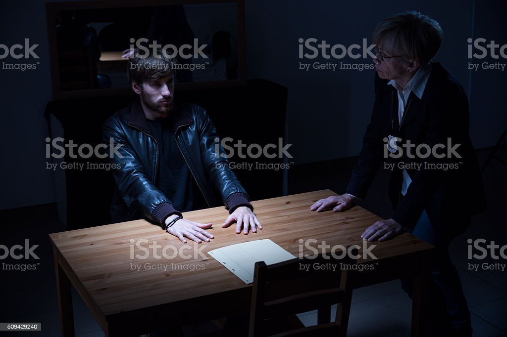 Policewoman asking questions stock photo