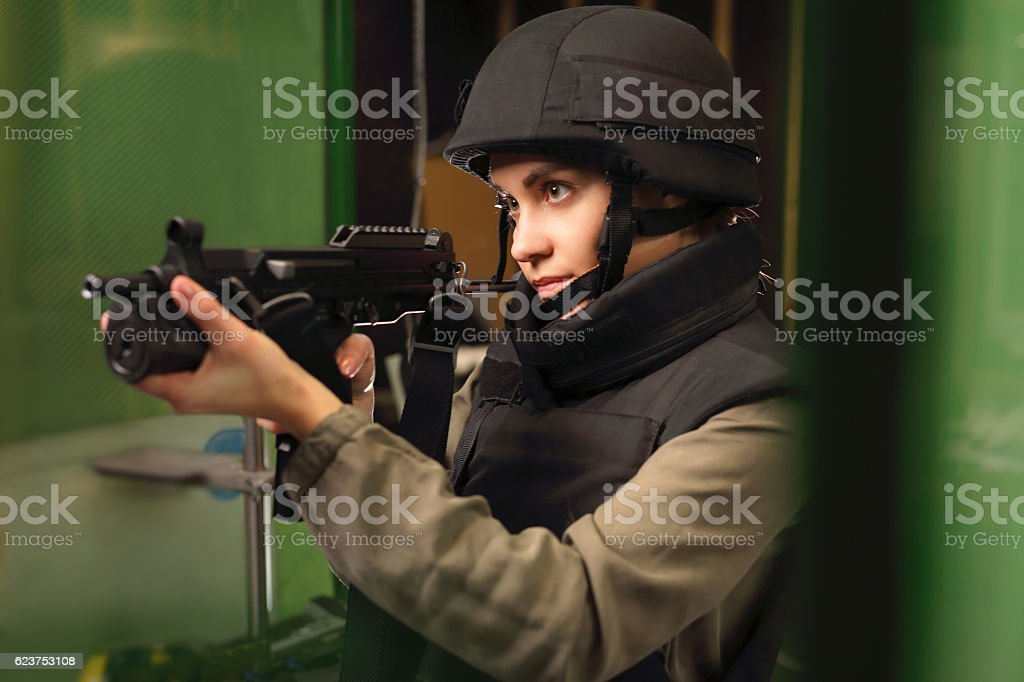 Policewoman at the shooting range with a rifle shot stock photo
