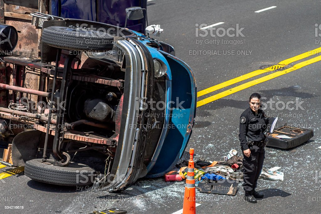 Policewoman directs traffic after a traffic accident stock photo