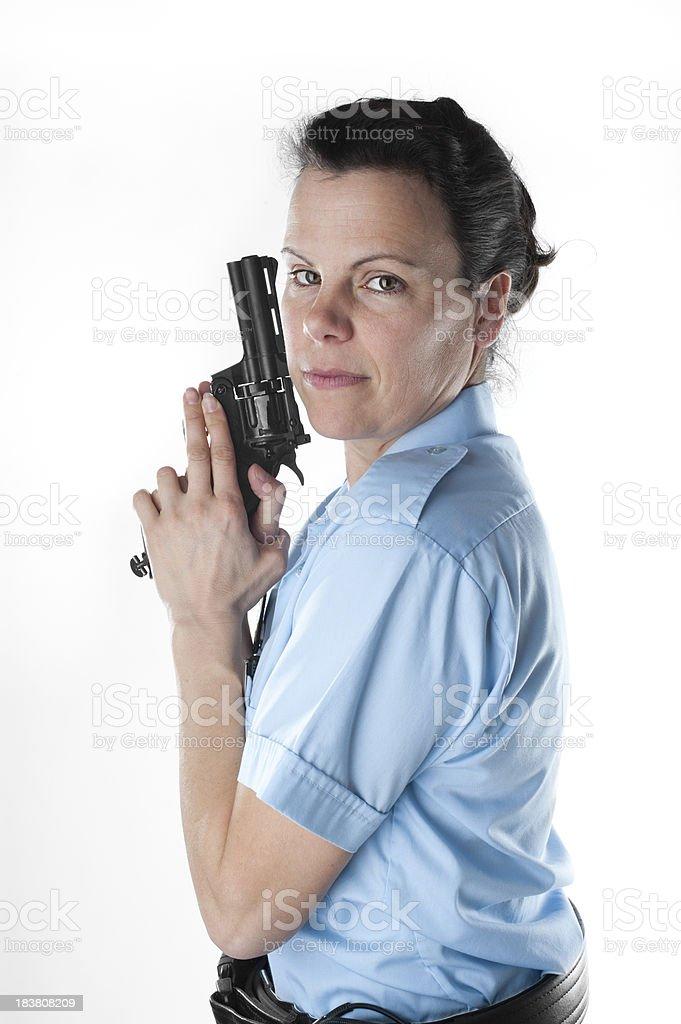 Policewoman ready to shoot stock photo