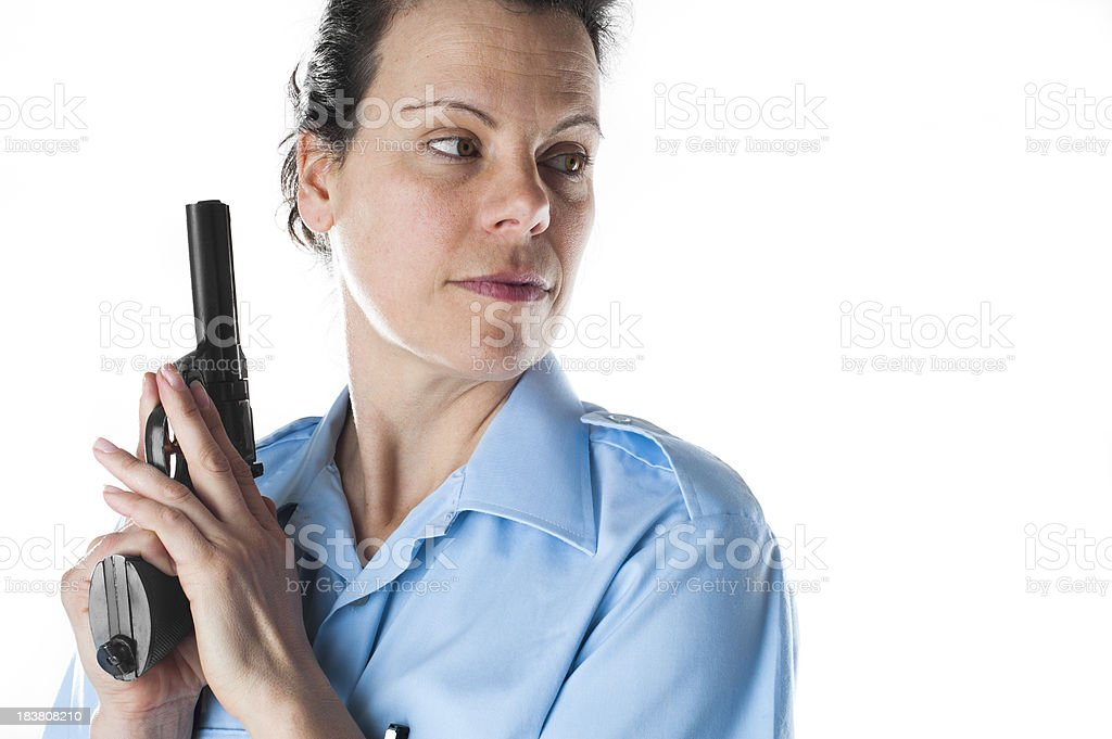 Policewoman ready to shoot royalty-free stock photo