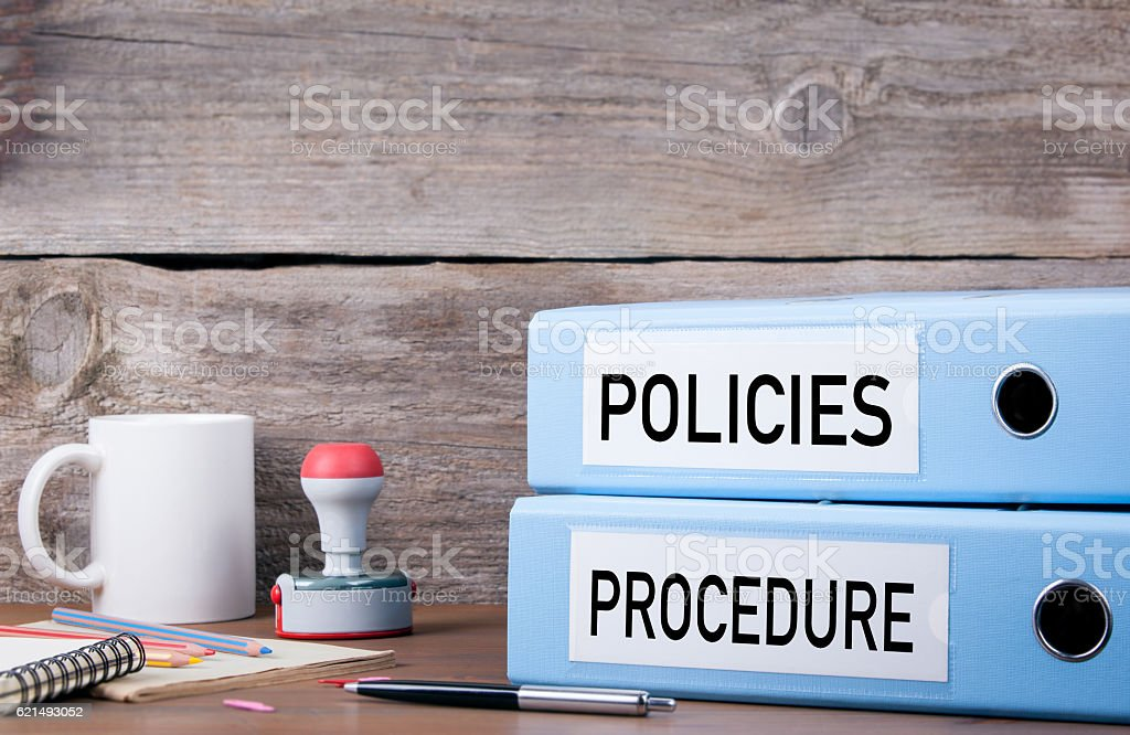 Policies and Procedure. Two binders on desk stock photo