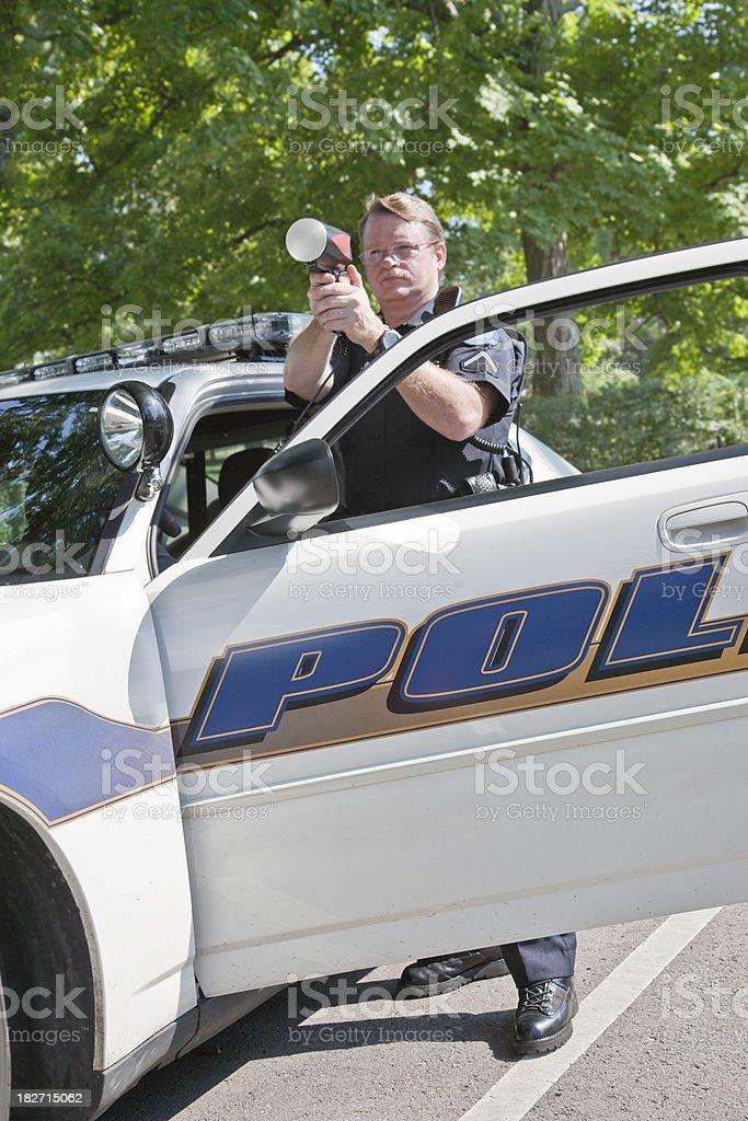 Policman Radar Gun royalty-free stock photo