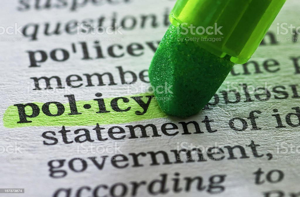 policy definition highlighted in dictionary stock photo