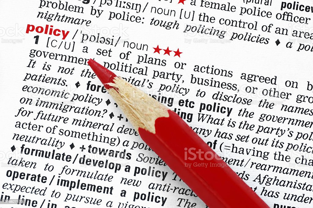 policy highlighted in dictionary red pen strategy royalty-free stock photo