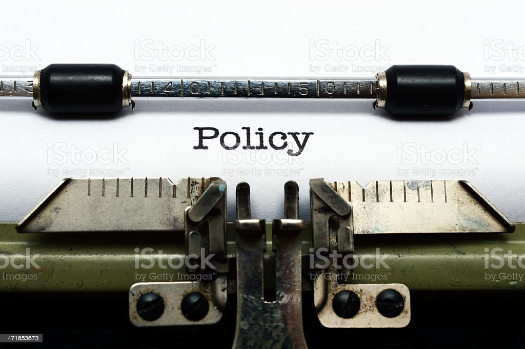 Policy on typewriter royalty-free stock photo