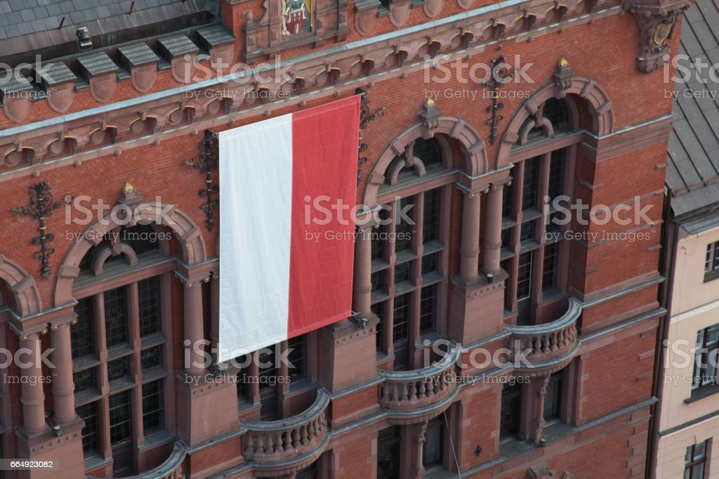 polish flag on old gothic facade tanement in Torun Poland central Europe classical urban architecture historic city building tourism holidays sightseeing stock photo