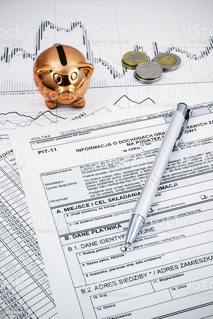 Polish income tax forms with pen, coins and piggybank royalty-free stock photo