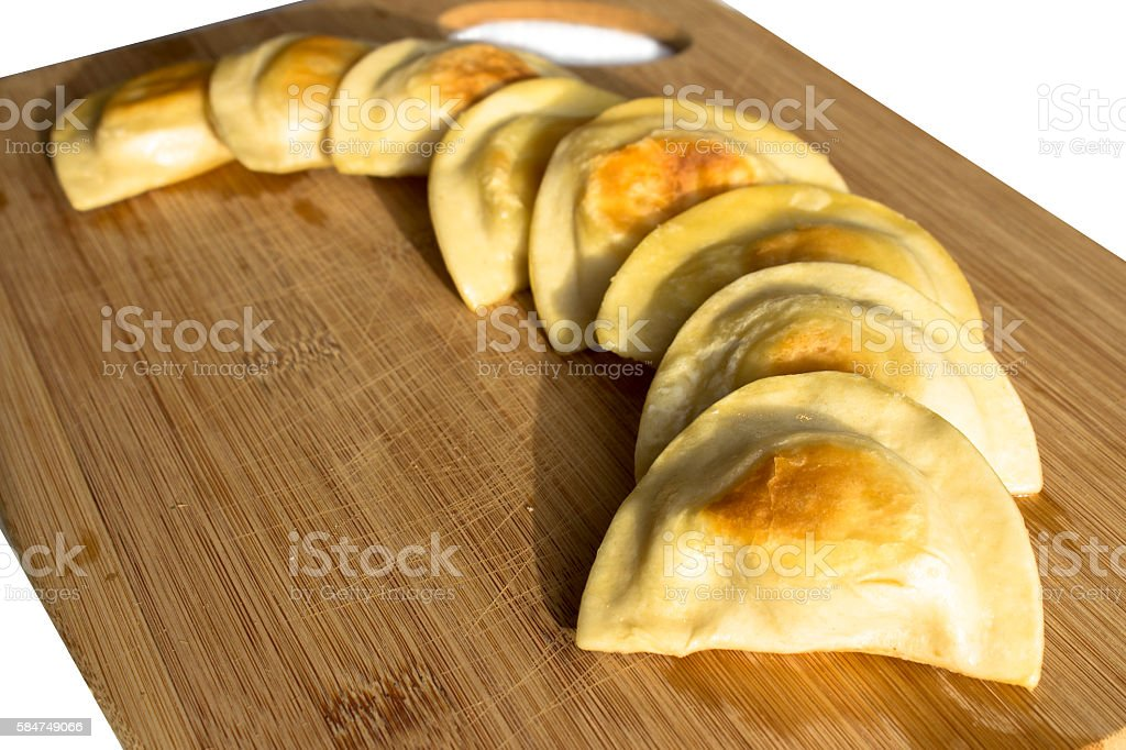 Polish pierogi laid out on a cutting board in a curve stock photo
