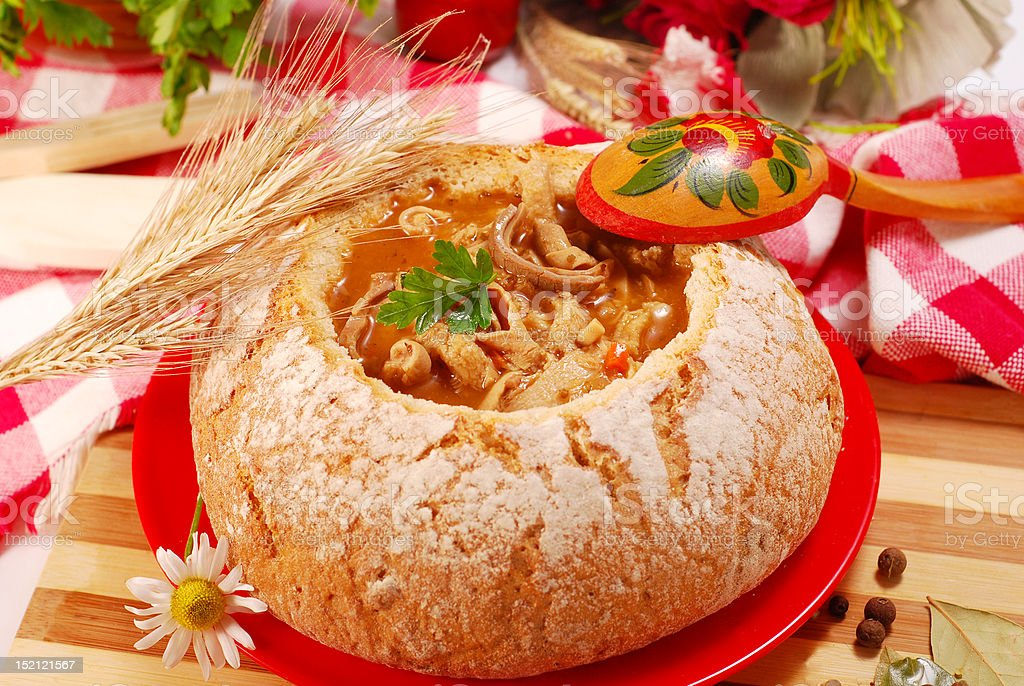 polish tripe soup (flaki) in bread bowl royalty-free stock photo