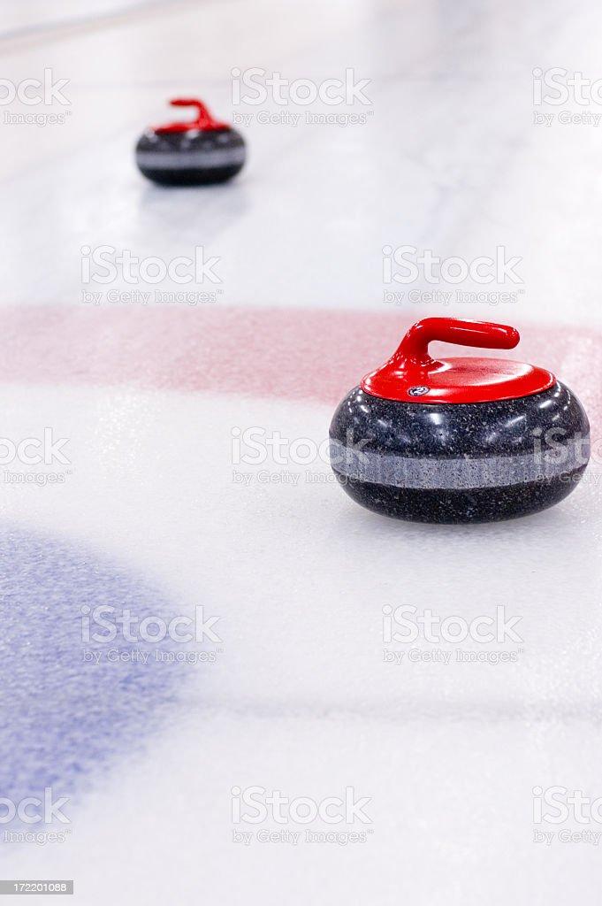 Polished granite curling rocks stock photo