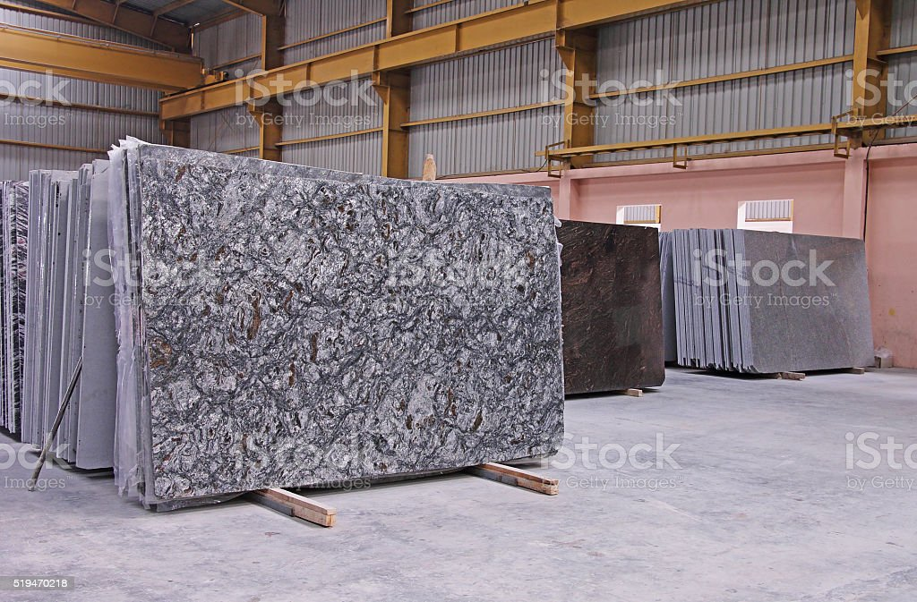 Polished Granite Floor Slabs Stacked in Warehouse stock photo