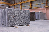 Polished Granite Floor Slabs Stacked in Warehouse