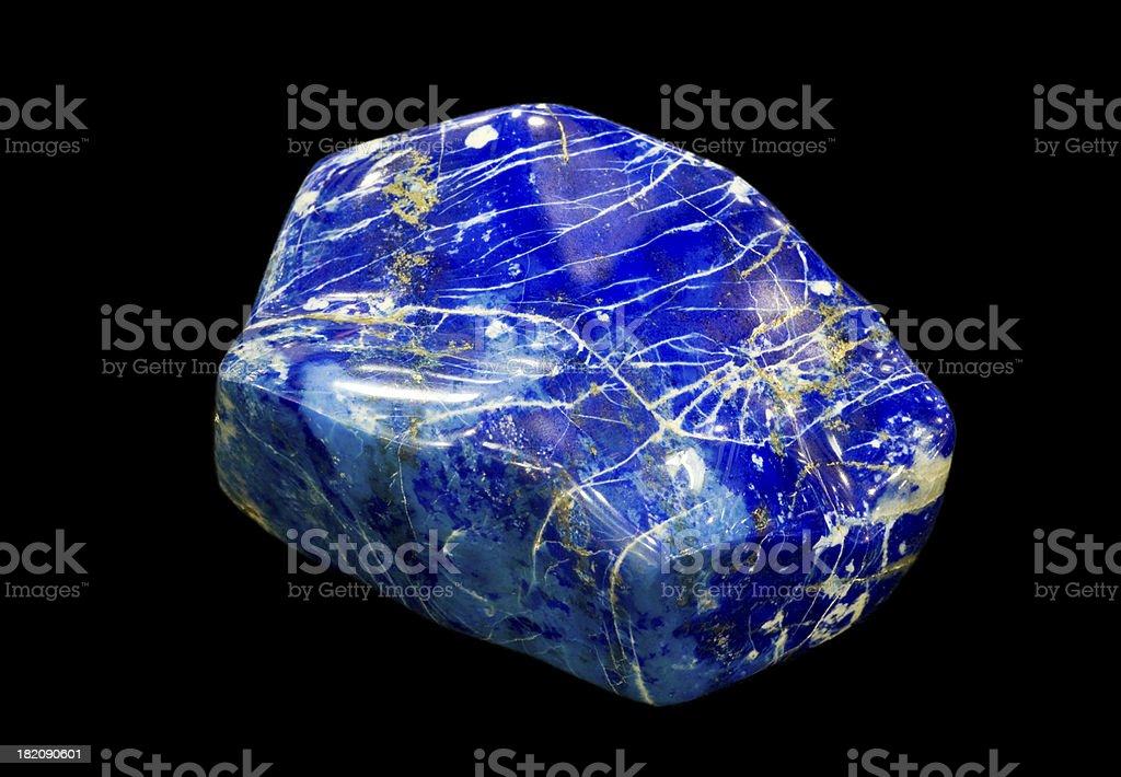 Polished Lapis Lazuli pebble isolated on black. royalty-free stock photo
