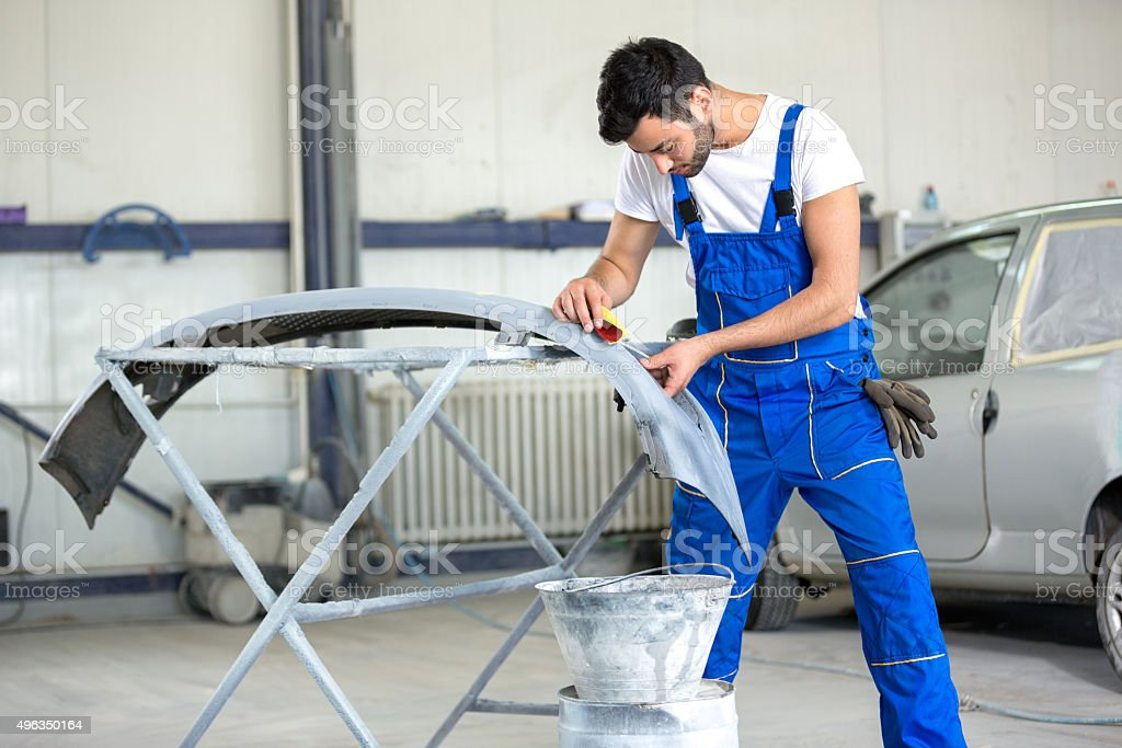 polishing bumper for paint job stock photo