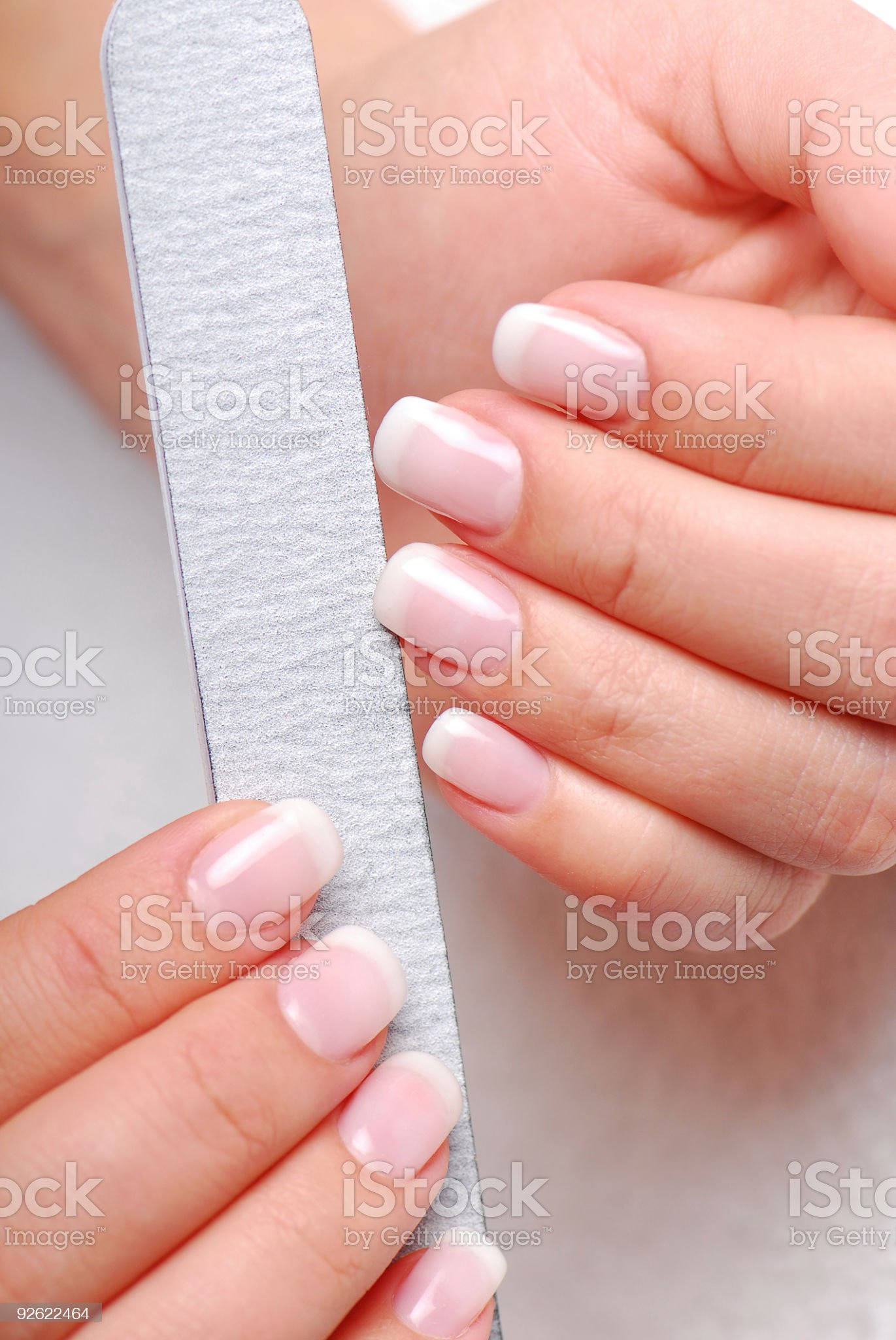 Polishing fingernails royalty-free stock photo