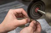 Polishing jewelry with a jewelry buffer machine.
