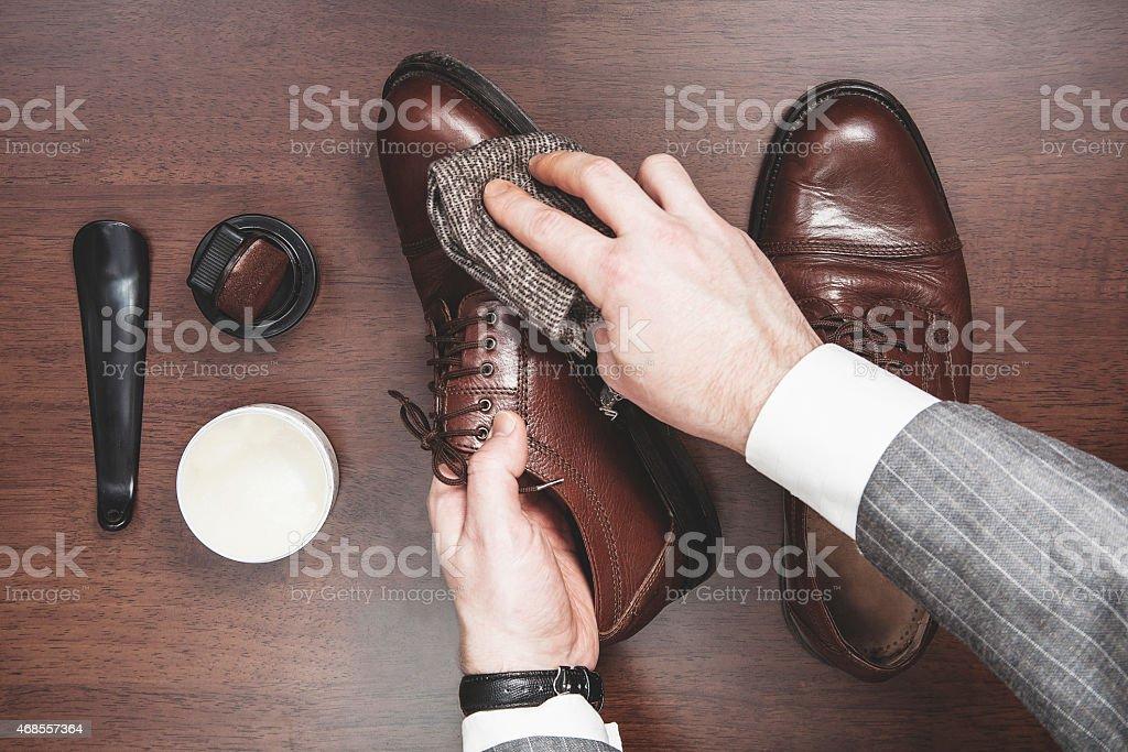 Polishing leather shoes stock photo