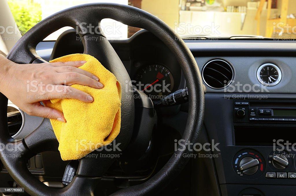 Polishing steering wheel royalty-free stock photo