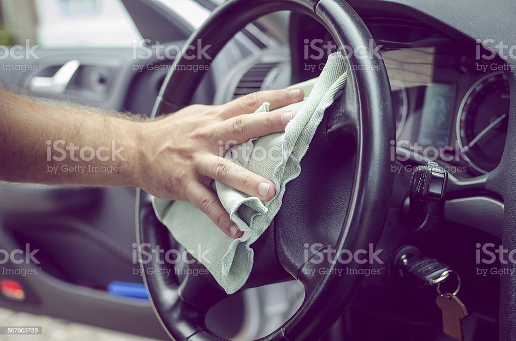 Polishing steering wheel stock photo