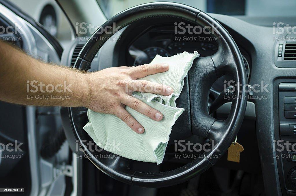 Polishing steering wheel stock photo