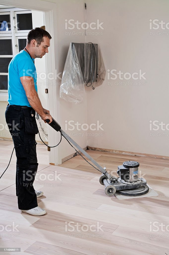 Polishing wooden floor stock photo