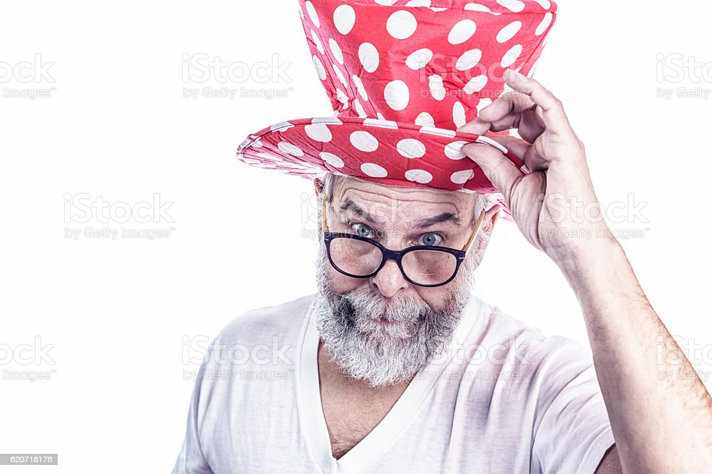 Polite Senior Adult Gentleman Clown Tipping Polka Dot Top Hat stock photo