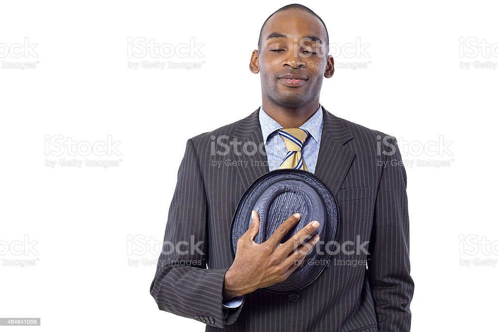 Polite Young Black Businessman Taking His Hat Off stock photo