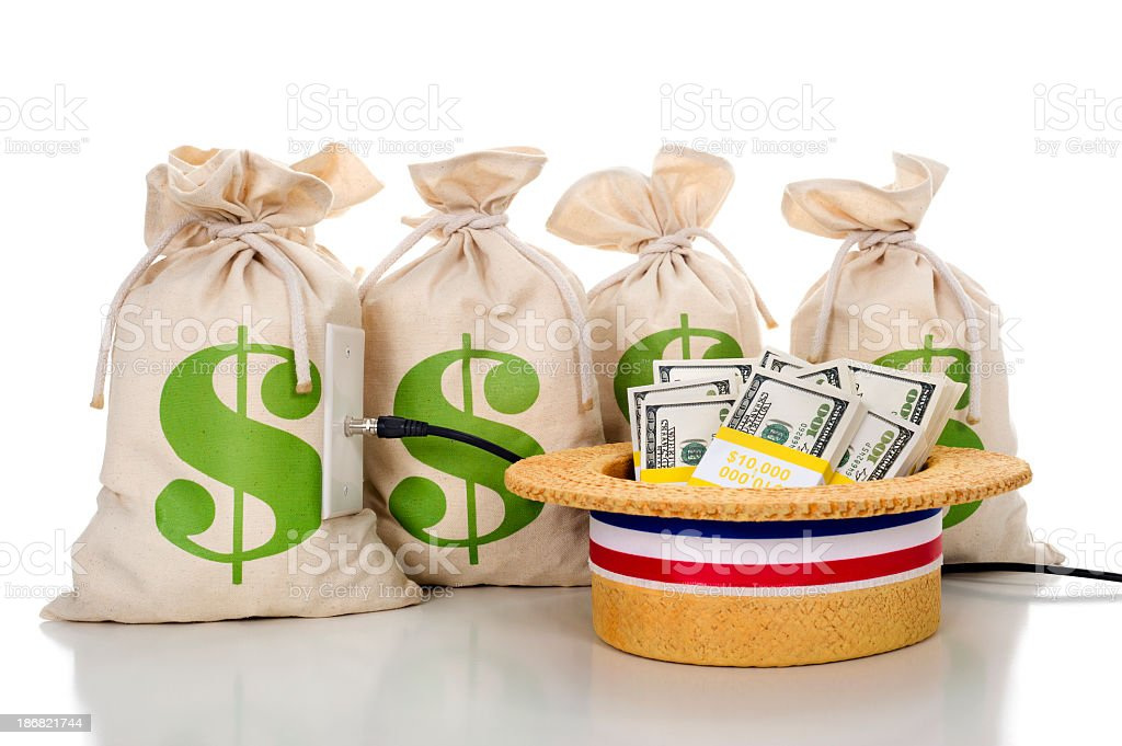 Political ad with money bags and a hat full of cash. stock photo