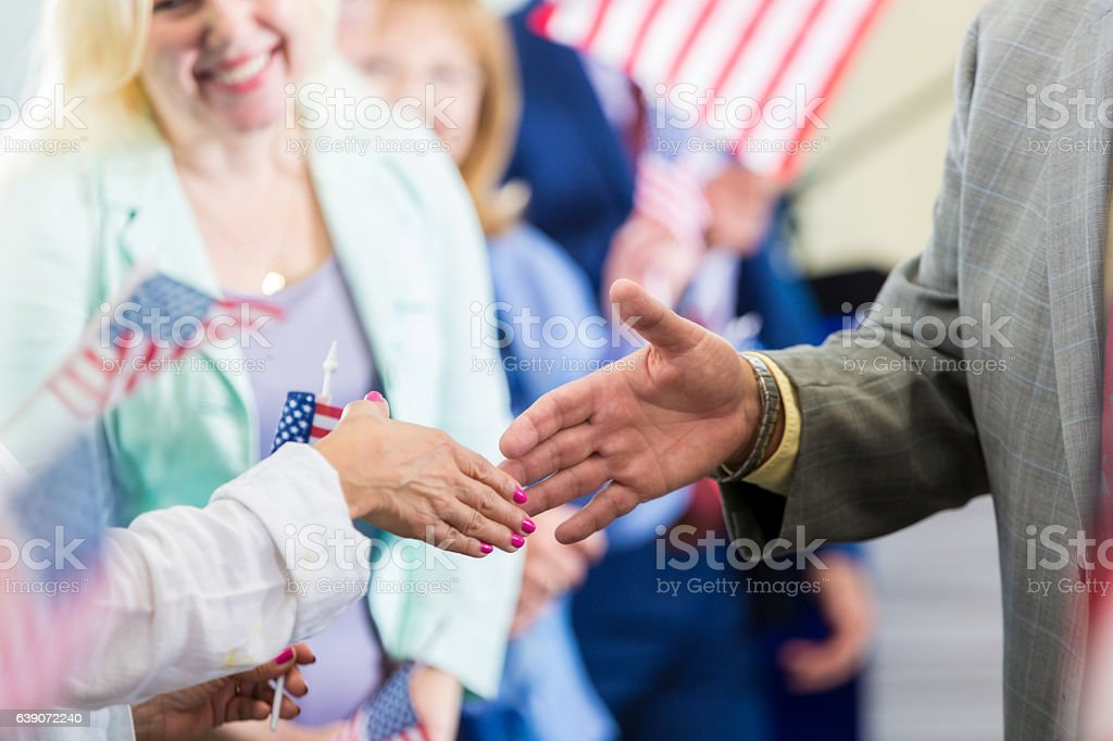 Political candidate greets supporters during rally stock photo