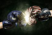 Political Crisis between USA and EU symbolized with Boxing Glove