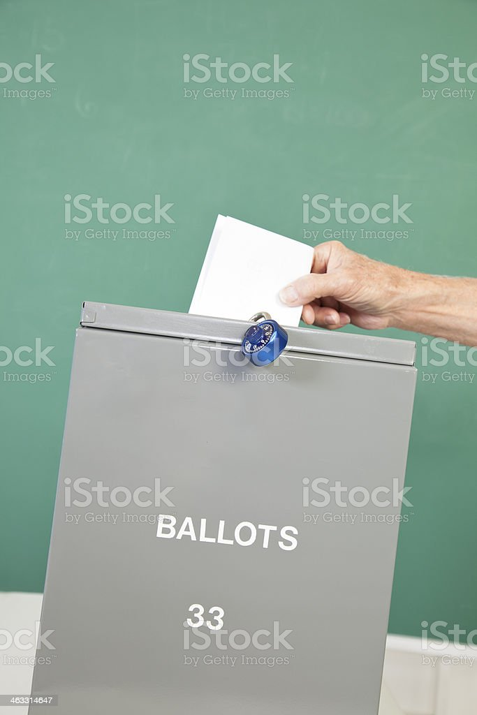 Political Election: Ballot put in box at pollling precinct. royalty-free stock photo
