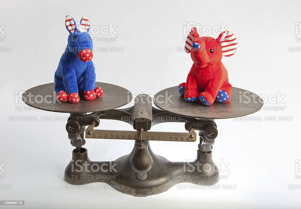 US political mascotts on antique scale stock photo