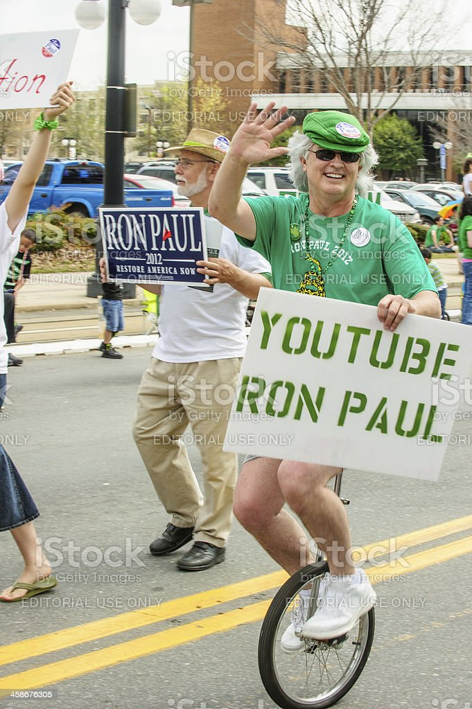 Political supporter on unicycle royalty-free stock photo