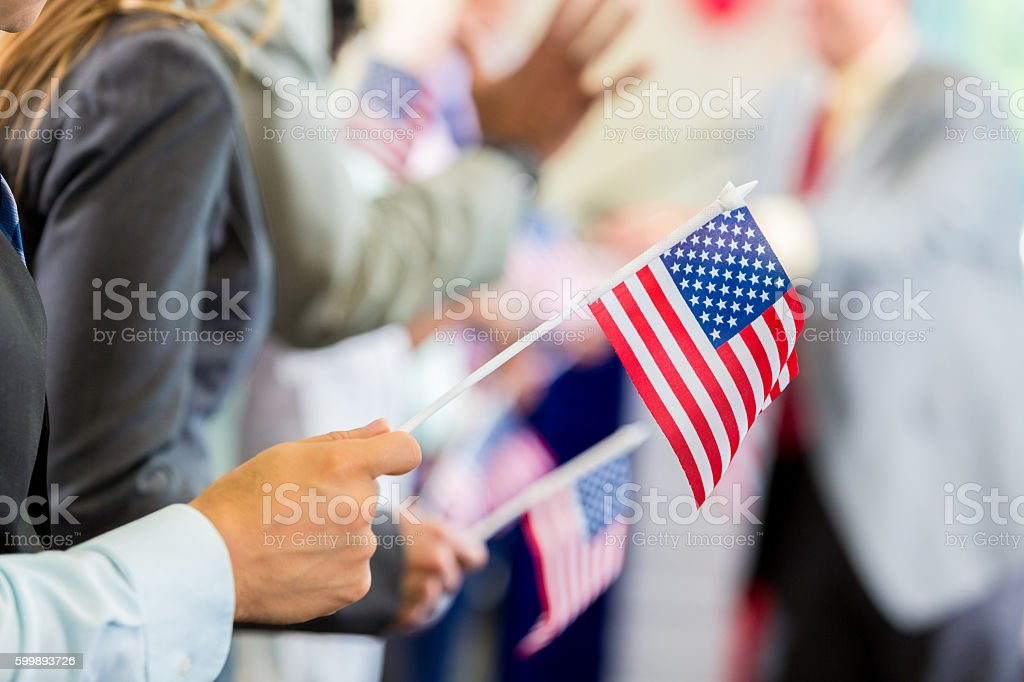 Political supporters waving flags during rally or speech stock photo