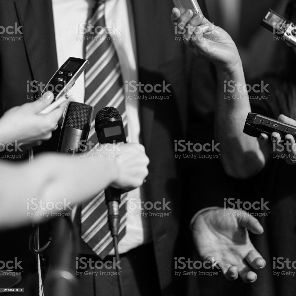 Politician answering questions stock photo