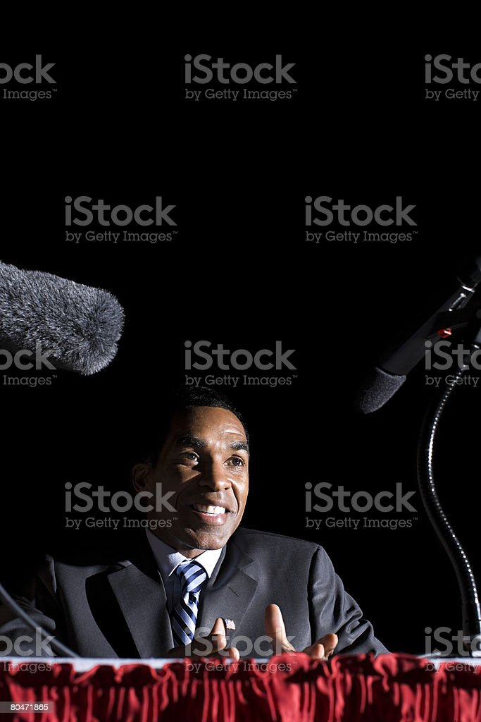 A politician giving a speech stock photo