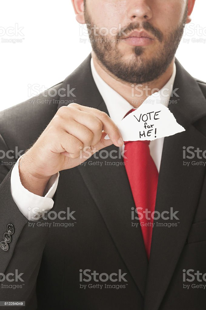 Politician holding a piece of paper saying Vote for Me! stock photo