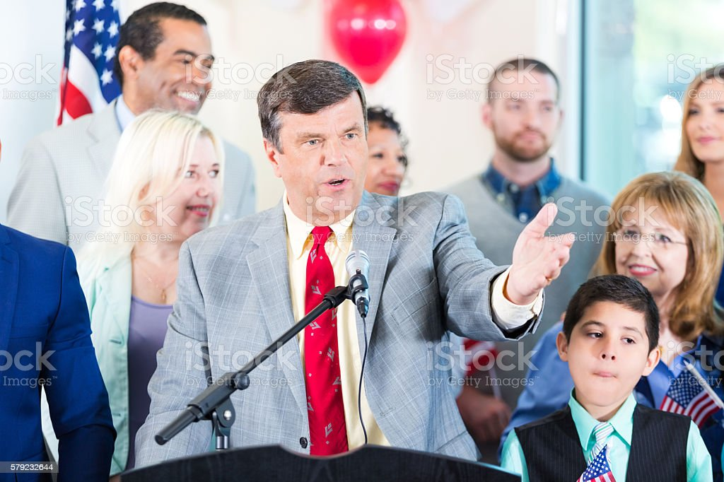 Politician making speech with supporters stock photo
