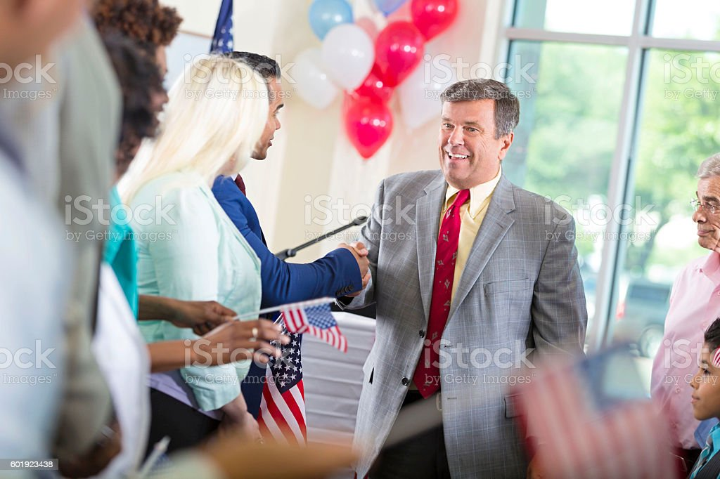 Politician running for local government office, greeting supporters stock photo
